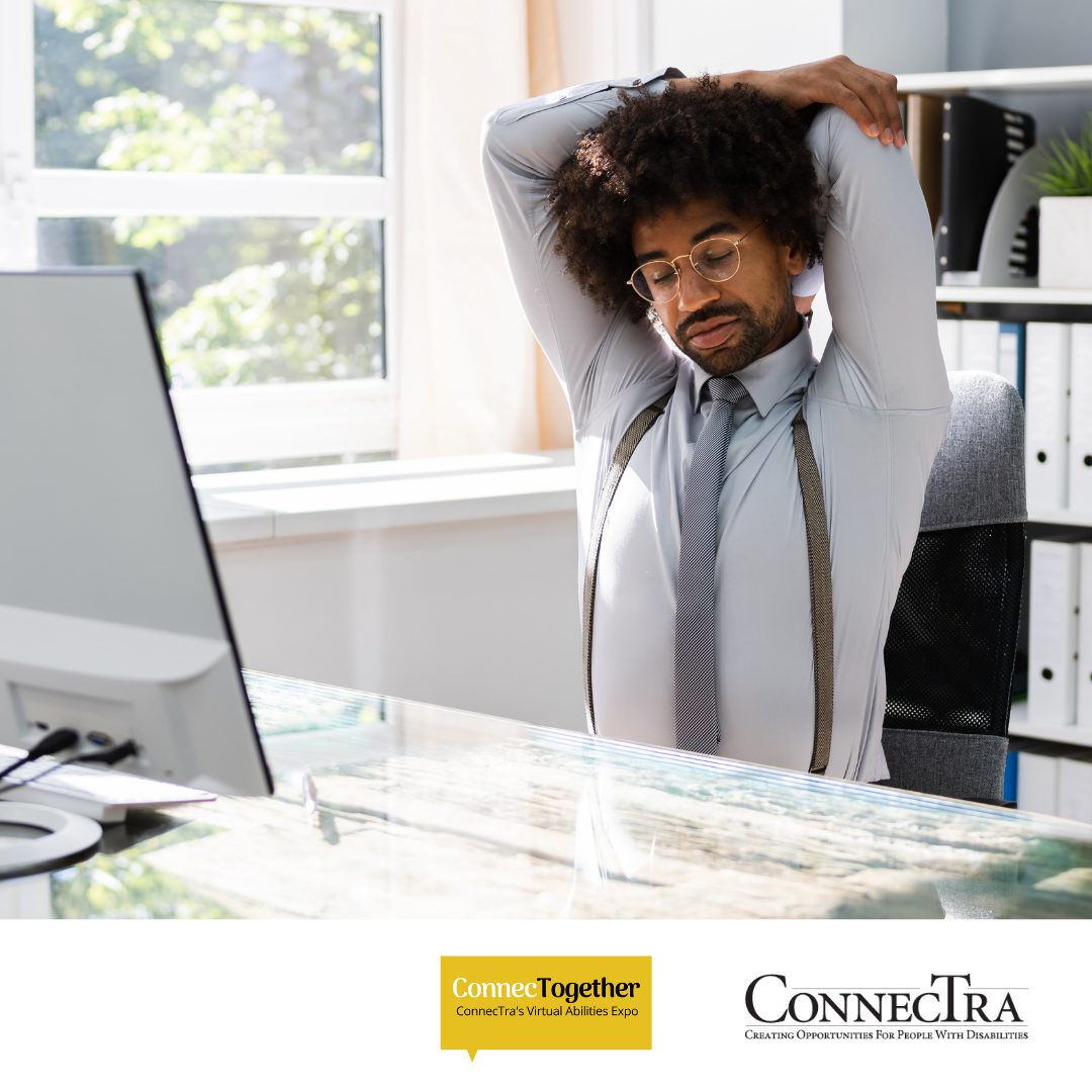 Young man doing yoga at his work desk.