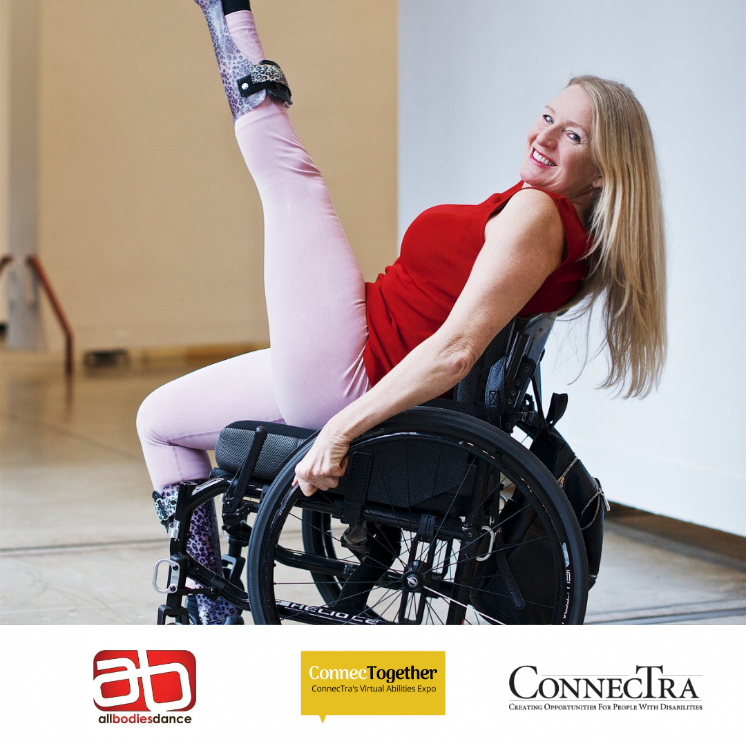 Janice striking a pose with her leg above her head while using her wheelchair.